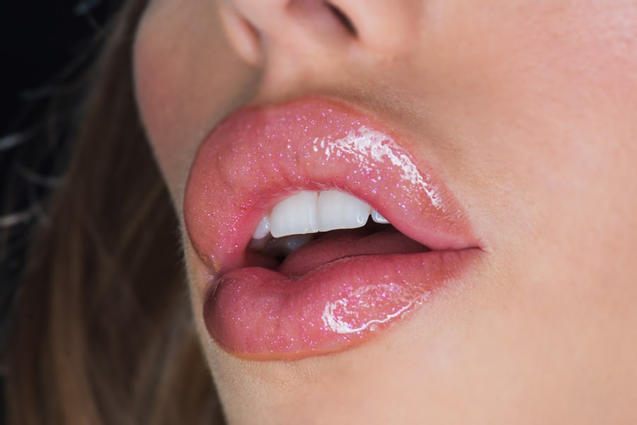 Smile a little. Sexy lips of sexi woman. Sexy woman with white smile. Silicone injection for lips. Silicone dental braces. Dental care. Botox treatment. Botox and filler. I love changing my makeup.